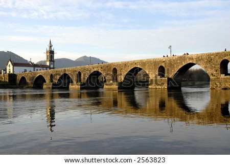 bridge and church of Ponte de Lima in Portugal - stock photo