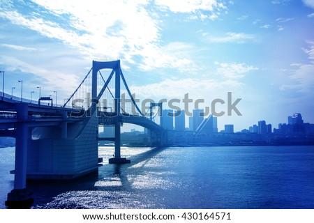 bridge and cityscape, rainbow bridge, tokyo, japan - stock photo