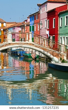Bridge and colourful houses in Burano. - stock photo