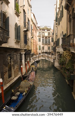 bridge and gondola on a Venice canal