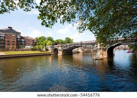 Bridge and modern apartments on the river, York, UK - stock photo