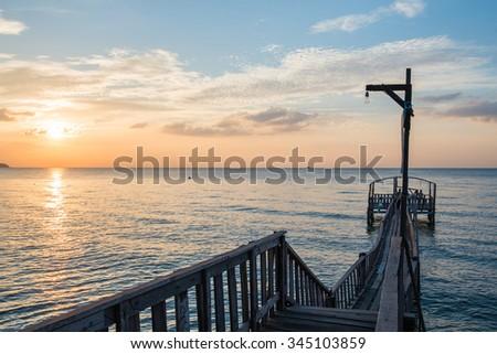 Bridge and pavilion on the sea with people walk on the bridge - stock photo