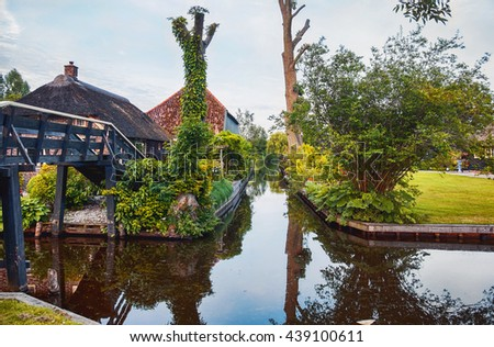 bridge and river in old dutch village, Giethoorn, Overijssel province in the Netherlands