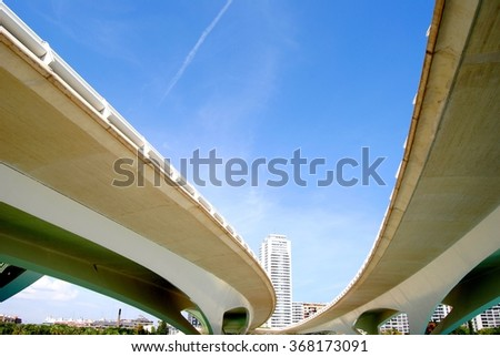 Bridge and roadway in city - stock photo