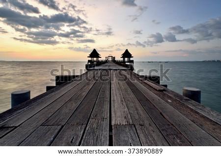 Bridge and sea at Jittapawan Temple in Pattaya, Chonburi, Thailand - stock photo