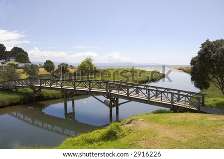 Bridge and stream leading into the ocean near Whitianga on the Coromandel  peninsula in New Zealand