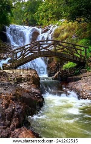 bridge and waterfall with the river in the wood (Vietnam, Asia) - stock photo