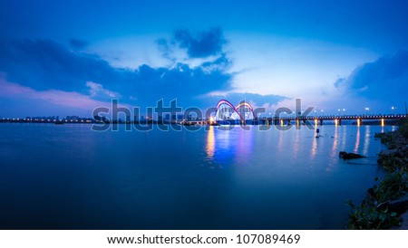Bridge at night, cities and roads - stock photo