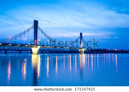 Bridge at night, cities and roads
