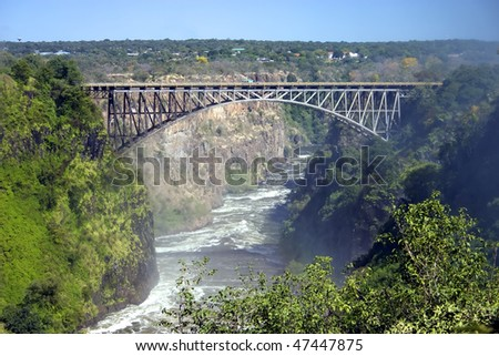 Bridge at Victoria fall at the boarder crossing between Zimbabwe and Zambia, showing the bungee jump - stock photo