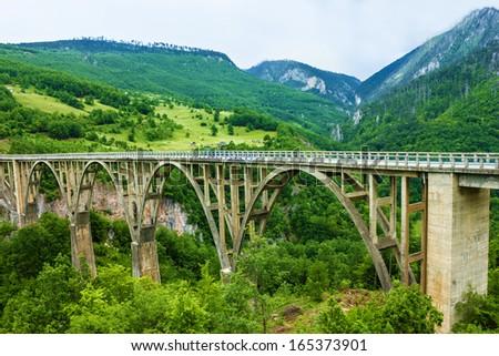 Bridge construction. Durdevica Tara arc bridge in the mountains, North of Montenegro.  - stock photo