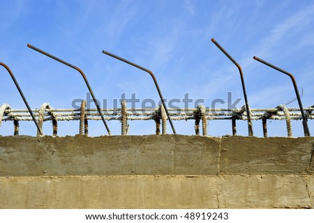 Bridge construction project: Reinforcing bars project from top of concrete abutment to connect to mating parts - stock photo
