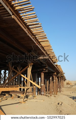 Bridge Construction Project: Temporary wood bracing, forms, walkways and steel shoring support roadway beams before concrete is poured - stock photo
