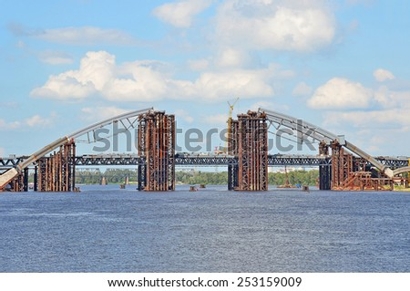 Bridge construction site across Dnieper river, Kiev, Ukraine - stock photo