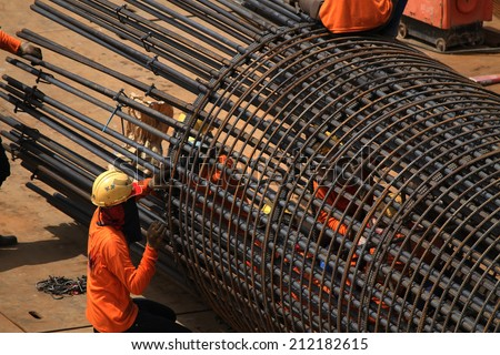 Bridge construction under performing the steel reinforcement of piling work. - stock photo