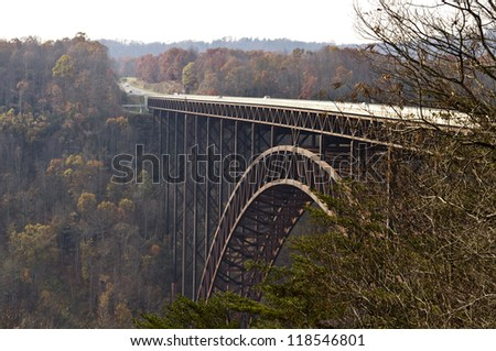 Bridge crossing New River Gorge, WV in beautiful autumn setting. - stock photo