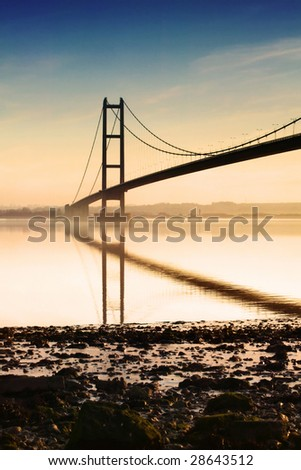 Bridge crossing the river humber - stock photo