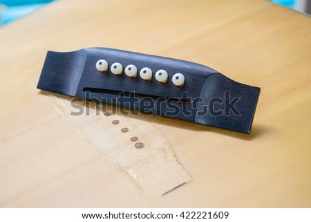 bridge guitar break from body and not have strings - stock photo