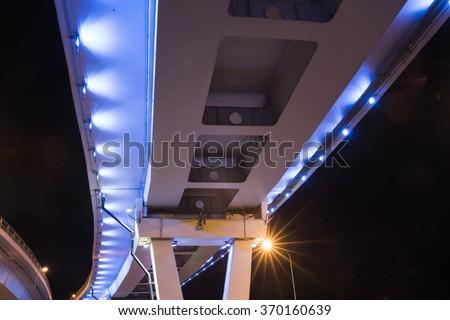 Bridge illuminated at night - stock photo