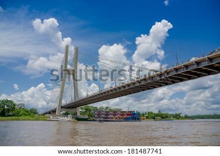 Bridge in Coca, Napo River in Ecuador's amazon basin - stock photo