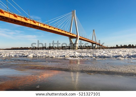 bridge in north of river covered with ice