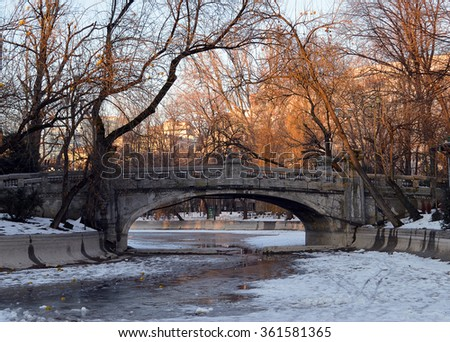 Bridge in park in snow, Bucharest, Romania