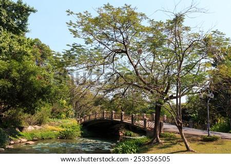 Bridge in the city park. - stock photo