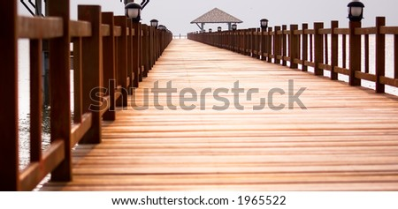 Bridge leading to dock. Low camera angle. - stock photo