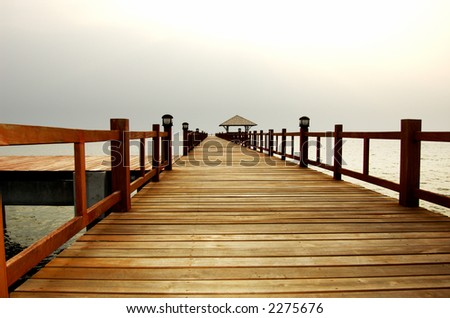 Bridge leading to dock. Low camera angle. - stock photo