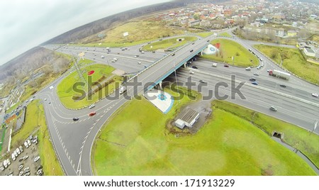 Bridge of Abramtsevskaya overpass on Moscow beltway at dull day. View from unmanned quadrocopter - stock photo