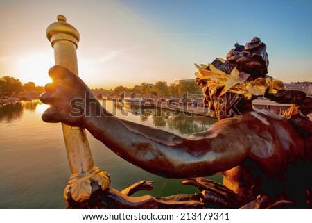 Bridge of Alexander III in Paris against sunset in France - stock photo