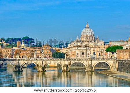 Bridge of Castle St. Angelo on the Tiber.Dome of St. Peter basilica, Rome - Italy