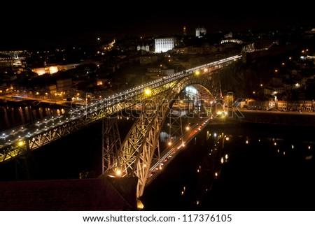 Bridge of Luis I at night over Douro river and Porto, Portugal - stock photo