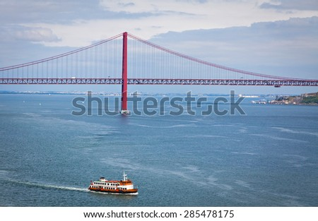 Bridge of 25th April over Tagus river in Lisbon, Portugal - stock photo