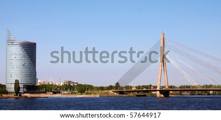 bridge on daugava river in riga, capital of latvia - stock photo
