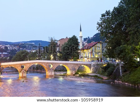Bridge on Miljacka river in Sarajevo the capital city of Bosnia and Herzegovina, at dusk - stock photo