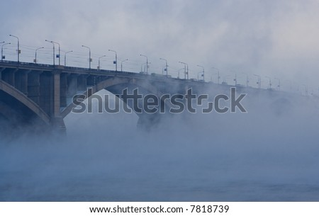 bridge on river in cold steam on blue