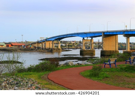 Bridge on the Bay of Fundy in Saint John New Brunswick, Canada at sunset - stock photo