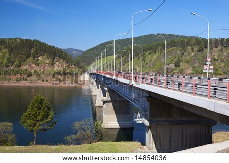 bridge on the river in siberia