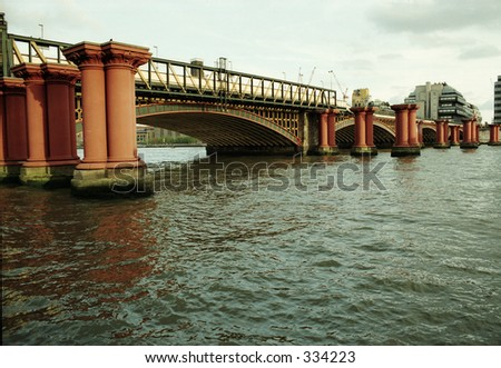 bridge on the Thames River in London - stock photo