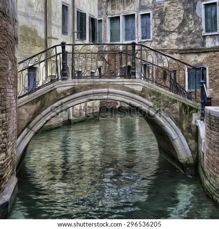 Bridge over a Canal in Venice, Italy - stock photo