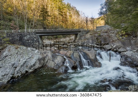 Bridge Over a Cascading River in Late Autumn - Smoky Mountains National Park, Tennessee - stock photo