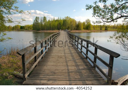 Bridge over a lake and into the unknown