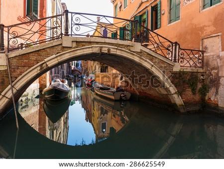 Bridge over a narrow canal in Venice - stock photo