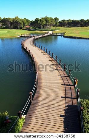 Bridge over an artificial pond. - stock photo