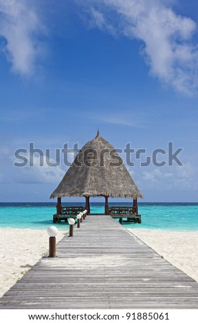 bridge over blue ocean on a tropical island. - stock photo