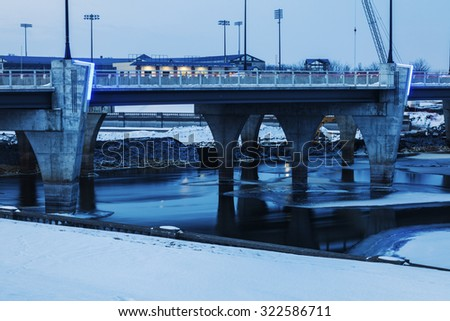 Bridge over frozen Des Moines River. Des Moines, Iowa, USA. - stock photo