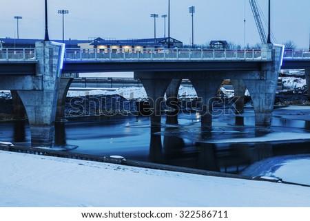 Bridge over frozen Des Moines River. Des Moines, Iowa, USA. - stock photo