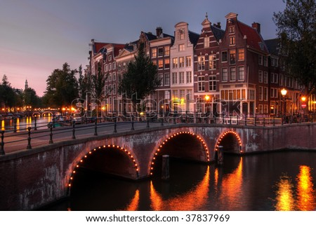 Bridge over Keizersgracht (Emperor's canal) in Amsterdam, The Netherlands at twilight (HDR image) - stock photo