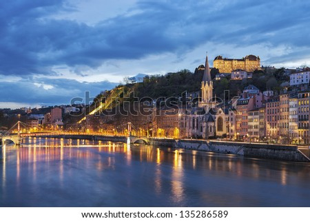 Bridge over river saone at night, Lyon, France - stock photo